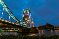Bridge Tower night view. From the bridge, London United Kingdom. A combined bascule and suspension bridge which crosses the River Thames and has become an Royalty Free Stock Photo