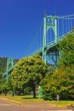 Bridge towering above a purpule hydrant Royalty Free Stock Images