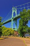 Bridge towering above a the river Royalty Free Stock Photography