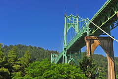 Bridge towering above the trees Stock Image