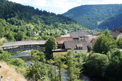 Bridge and town in the Black Forest, Germany. Roofed wooden bridge in the Murg Valley, landmark of Forbach, river in the northern Black Forest in Baden Royalty Free Stock Images