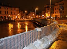 Bridge in town with sandbags during a flood in Italy Stock Photos