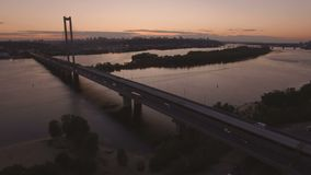 Bridge with trafic over the river at sunset aerial drone footage. 4K stock video footage