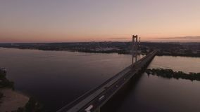 Bridge with trafic over the river at sunset aerial drone footage. 4K stock footage