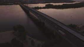 Bridge with trafic over the river at sunset aerial drone footage. 4K stock video