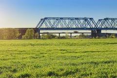 Bridge of train railway cross grass field meadow and river.  Royalty Free Stock Photos