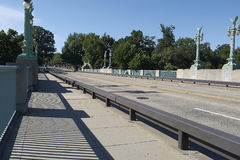 Bridge with trees in background. Walkway on a bridge in Washngton DC. Ornate street lights line the road Stock Photos