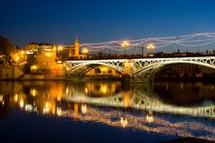 Bridge triana sevilla andalucia spain at night with lights royalty free stock photos
