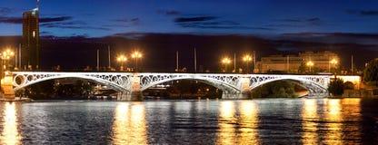 Bridge of Triana in Sevilla at night, Spain stock photography