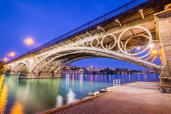The Bridge of Triana. Seville is divided in two by the river Guadalquivir, and its most famous bridge is the Triana bridge, connecting the historic center to the stock image