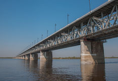 The bridge troght the river Amur. Stock Images