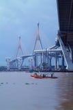 Bridge and tug-boat in Bangkok, Thailand Stock Photos