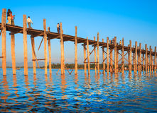 Bridge U-Bein. Teak bridge is the longest. Sunset with silhouettes of people unrecognizable Royalty Free Stock Images