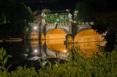 Bridge of Umberto I Turin, Italy by night. Stock Photos