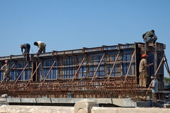 Bridge under construction. On highway in India with workers Royalty Free Stock Photography
