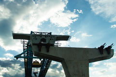 The bridge under construction. With blue sky and white clouds Stock Photo