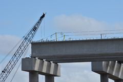 A bridge under construction with crane Royalty Free Stock Photography