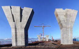 Bridge under construction, massive reinforced concrete support o Royalty Free Stock Photo