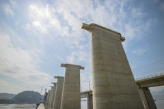 Bridge is under construction on the river in China Royalty Free Stock Photo