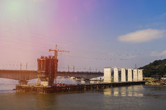 Bridge is under construction on river in China Royalty Free Stock Image