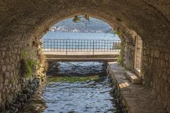 A bridge under the old arch at sea. people do not. Old Royalty Free Stock Photography