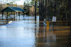 Bridge under water. Heavy rains flooded the Choctawhatchee River in Ebro, Florida resulting in this bridge and road being under water Stock Image