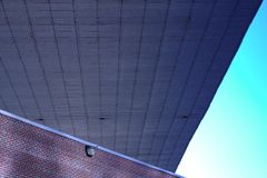 Bridge underpass and brick building Royalty Free Stock Photography