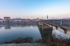 A bridge that connects two parts of the city. A bridge that unites two parts of the city and despite the passing years remains there to face floods and bad stock photo