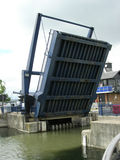 Bridge up. Road bridge is lifted to allow boats to enter the marina Stock Photography