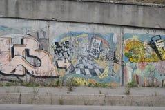 A bridge vandalized with street graffiti art Stock Photos