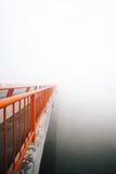 Bridge vanishing in fog Stock Image