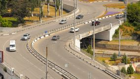 A bridge for vehicles. City transport bridge over the railway crossing. Movement of vehicles along the bridge in the city limits stock footage