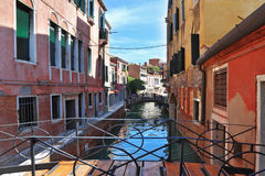 The bridge through the Venetian channel Royalty Free Stock Images