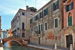 The bridge through the Venetian channel Stock Images