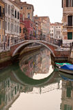 Bridge in Venice. Bridge over a Venetian Canal. Reflections are on the water Royalty Free Stock Photography