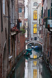 Bridge in Venice. Bridge over a Venetian Canal. Reflections are on the water Stock Image