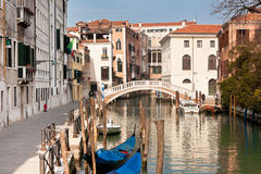 Bridge in Venice. Bridge over a Venetian Canal. Sunny landscape Stock Photos