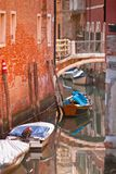 Bridge in Venice. Bridge over a Venetian Canal. Reflections are on the water Royalty Free Stock Image
