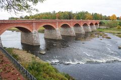 A bridge on the Venta River in Kuldiga Latvia Royalty Free Stock Photo