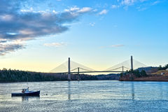 The bridge at Verona Island Maine. Distant view of the new Verona Island Maine bridge with a lobster boat in the foreground in the early morning light Royalty Free Stock Photography