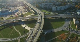 Bridge Viaduct road traffic machine Drone fast time cars in motion. Riga city drone flight above bridge with cars frafics builders in process stock footage