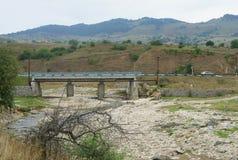 Bridge. View of the bridge on a background of mountains Stock Photo
