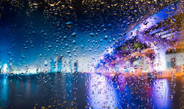 Bridge A view of the city from a window from a high point during a rain. Focus on drops Royalty Free Stock Image