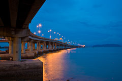 Bridge view at dusk. Penang bridge view in the evening with deep blue sky and sea Royalty Free Stock Photos
