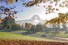 Bridge view in a foggy autumn morning Stock Photos