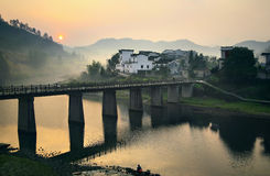 Bridge with village Stock Photography