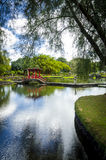 Bridge on Waihonu Pond. Red Japanese style bridge on Waihonu pond at Liliuokalani Gardens in Hilo, Hawaii Stock Image