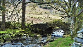 Stone bridge at wasdale lake. England. The bridge was photographed on the way to scafell pike highest English peak, at the wasdale lake cumbria Stock Photography