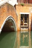 Bridge on a water canal in Venice, Italy Royalty Free Stock Image