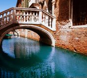 Bridge through water channel. In Venice Stock Image